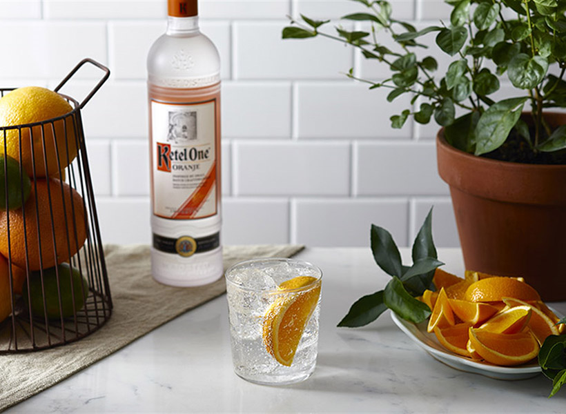 Ketel Soda with an Orange Wedge & Ketel One Oranje Bottle - Vodka Soda Recipe - Ketel One Vodka